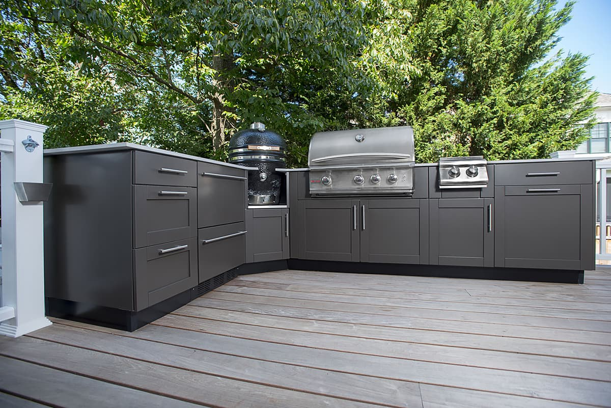 outdoor kitchen with grill and grey cabinets
