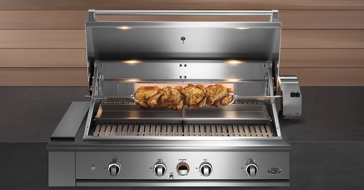 open DCS grill with chicken on rotisserie