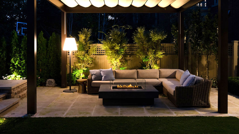 patio with fire pit at night