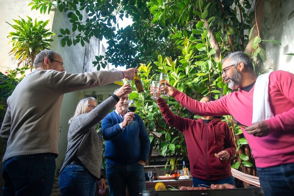 friends toasting in backyard